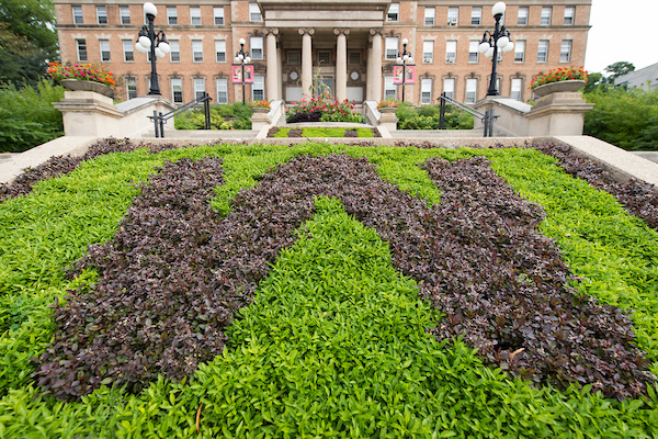"""A flowerbed planted in the shape of a """"W"""" in front of Agricultural Hall."""